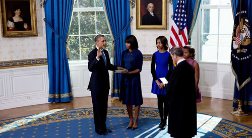 President Obama takes the oath of office at the official swearing-in ceremony in the Blue Room of the White House on Jan. 20, 2013. /AP
