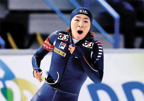 Lee Sang-Hwa reacts after setting a new world record in the womens 500-m race during the ISU Speed Skating World Cup competition in Calgary, Canada on Sunday.