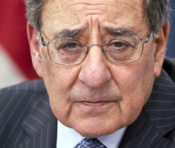 Defense Secretary Leon Panetta participates in a news conference at the Pentagon on Jan. 24, 2013, where he announced he is lifting a ban on women serving in combat. /AP