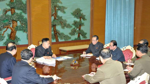 North Korean leader Kim Jong-un (center) meets with a panel of top security officials and diplomats, in this picture released Sunday by the [North] Korean Central News Agency. /KCNA-Yonhap