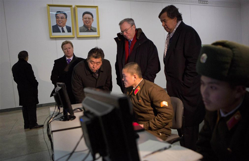 Executive Chairman of Google Eric Schmidt and former governor of New Mexico Bill Richardson look at soldiers working on computers at a computer lab in Pyongyang on Jan. 9, 2013. /AP