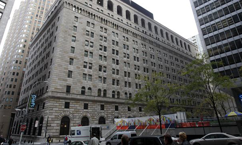 Pedestrians pass the Federal Reserve Building, New York on Oct. 17, 2012. /AP