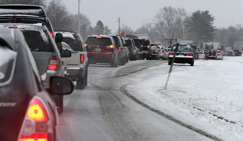 Cars are stuck in traffic as a winter storm arrives, in Newington, New Hampshire on Feb. 8, 2013. /AP