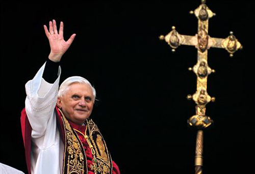 Pope Benedict greets the crowd from the central balcony of St. Peters Basilica at the Vatican on April 19, 2005. /AP