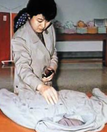 In this file photo, Kim Jong-iIs wife Ko Yong-hui repairs the late leaders anorak. /Courtesy of Mainichi Shimbun
