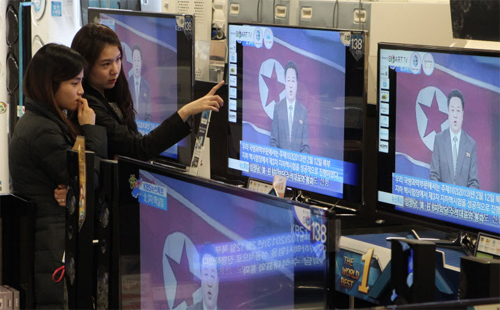 Women watch breaking news in a department store in Seoul on Tuesday as North Korea conducted another nuclear test.