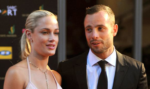 Oscar Pistorius might claim self defense against charges he murdered girlfriend Reeva Steenkamp (left) seen here with the sprinter at an awards ceremony in Johannesburg, South Africa on Nov. 4, 2012. /AP