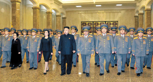 North Korean leader Kim Jong-un and his wife Ri Sol-ju pay their respects at Kumsusan Palace of the Sun on Saturday to mark the 71st birthday of the regimes late leader Kim Jong-il. /Rodong Sinmun