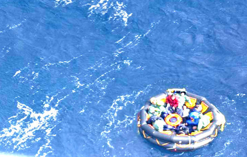 Wrecked sailors from a cargo vessel wait to be rescued in a rubber dinghy in waters near Ulleung Island on Thursday. /Courtesy of  Korea Coast Guard