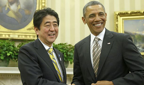 President Barack Obama shakes hands with Japans Prime Minister Shinzo Abe in the Oval Office of the White House on Feb. 22, 2013. /AP