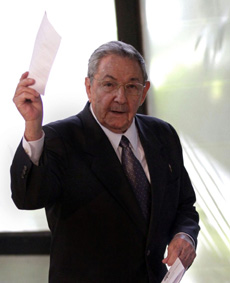 Cubas President Raul Castro holds up the ballot of his brother Fidel, also present in the session, for president of the National Assembly during the opening session of the parliament in Havana, Cuba on Feb. 24, 2012. /AP