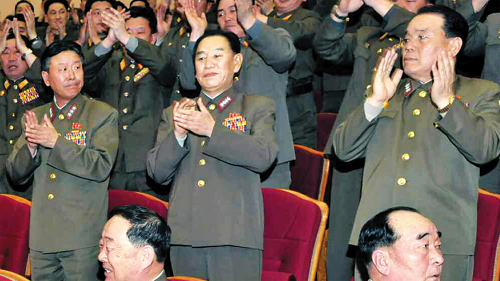 Kim Young-chol (center), the head of North Koreas Reconnaissance General Bureau, attends a musical performance in a uniform with the insignia of a four-star general, in a photo run by the Rodong Sinmun on Tuesday.