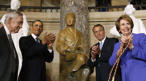 U.S. President Barack Obama (center) applauds after the unveiling of the Rosa Parks statue in the U.S. Capitol in Washington on Feb. 27, 2013. /Reuters