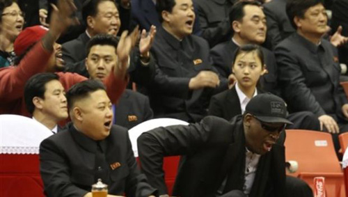 North Korean leader Kim Jong-un (left) and former NBA star Dennis Rodman watch North Korean and U.S. players in an exhibition basketball game in Pyongyang on Feb. 28, 2013. /AP