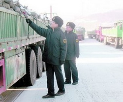 Chinese customs officers in Changbai inspect a truck of minerals from North Korea in this photo from the website of the General Administration of Quality Supervision, Inspection and Quarantine of China.