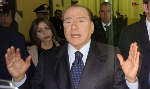 Former Italian Premier Silvio Berlusconi speaks to reporters after a hearing in his Mediaset appeals trial, at Milans court, Italy on March 1, 2013. /AP