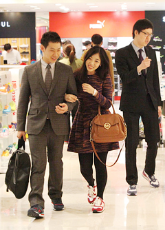 Shoppers wear sneakers with formal clothes at a department store in Seoul on Wednesday. /Courtesy of Lotte Department Store