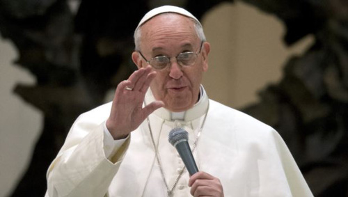 Pope Francis speaks during a meeting with the media at the Pope VI hall, at the Vatican on March 16, 2013. /AP
