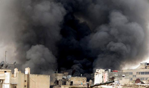 A citizen journalism image provided by Aleppo Media Center, which has been authenticated based on its contents and other AP reporting, shows black smoke rising from buildings due to government forces shelling, in Aleppo, Syria on March 19, 2013. /AP