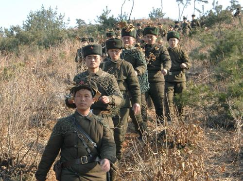 North Korean soldiers in a training /[North] Korean Central News Agency