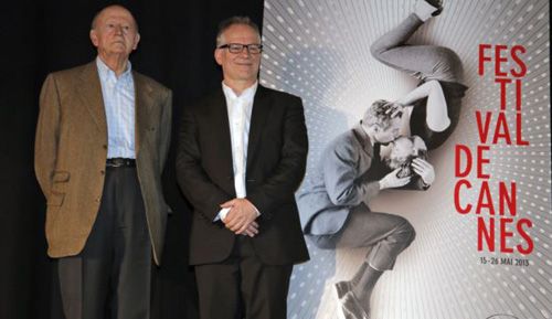 President of the Cannes Film Festival Gilles Jacob (left) and artistic Director Thierry Fremaux pose in front of the Cannes International Film Festival poster for the upcoming 66th edition, during a press conference to announce this years lineup in Paris on April 18, 2013. /AP