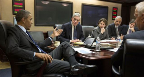 President Obama meeting with national security team to discuss developments in the Boston on April 19, 2013. /AP