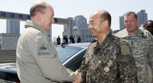 South Korean Joint Chiefs of Staff Chairman Gen. Jung Seung-jo (center) shakes hands with his U.S. counterpart, Gen. Martin Dempsey as U.S. Gen. James D. Thurman, the commander of U.S. forces in South Korea looks on in Seoul April 21, 2013. /AP