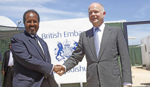 British Foreign Secretary William Hague (right) shakes hands with Somali President, Hassan Sheikh Mohamud, at the opening of the newly built British Embassy in the Somali capital Mogadishu on April 25, 2013. /AP