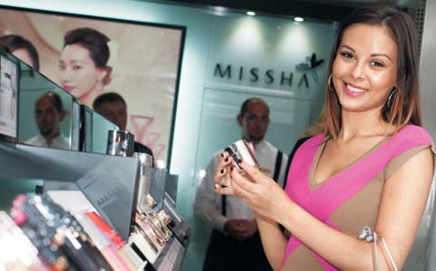 A customer shops at a branch of Korean cosmetics brand Missha in Brno, the Czech Republic.
