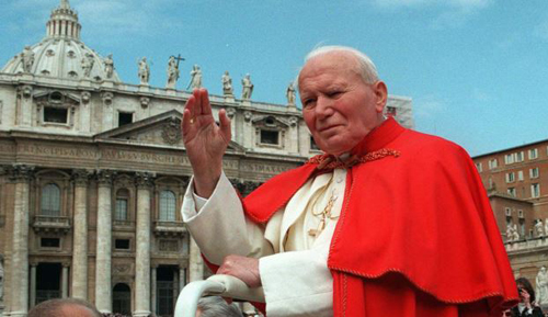 In this file photo taken on April 23, 1997, Pope John Paul II waves to faithful as he crosses St. Peters Square at the Vatican. /AP