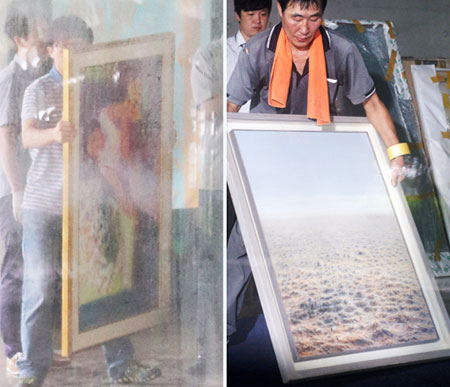 Investigators move artworks confiscated at the publishing company run by Chun Jae-kook in Paju, Gyeonggi Province on Thursday. /Newsis