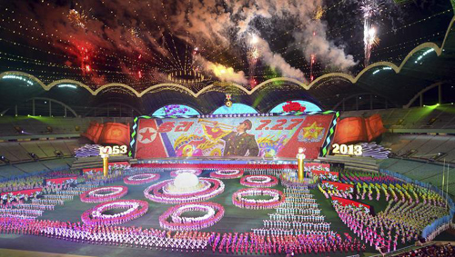 North Koreans put on gymnastics and arts performances in Pyongyang on Monday, as part of celebrations ahead of the 60th anniversary of the end of the 1950-53 Korean War in this photo released by North Koreas KCNA News Agency. The word reads