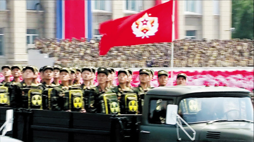 North Korean Soldiers carrying backpacks with a radioactive symbol are seen during a mass military parade on Kim Il-sung Square in Pyongyang to mark the 60th anniversary of the Korean War armistice on Saturday. /North Koreas Korean Central News Agency