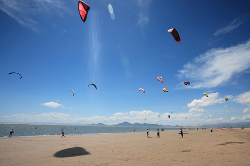 Kiteboarders make for scenic views at Dadaepo Beach.
