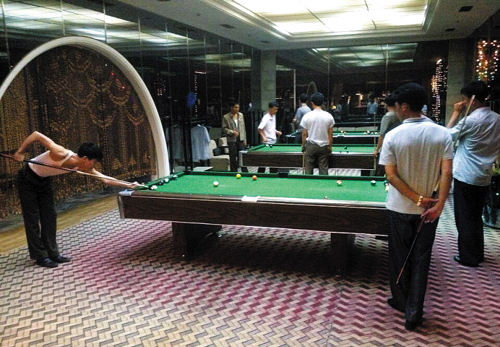 In this picture tweeted by CNNs Ivan Watson on, North Korean men play snooker in Pyongyang.