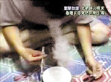 This screen grab from Asahi TV shows a North Korean smoking a narcotic substance.