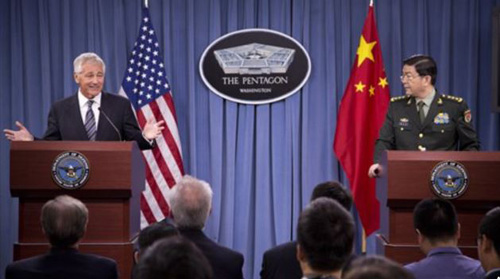 Defense Secretary Chuck Hagel gestures during a joint news conference with Chinese Minister of Defense Gen. Chang Wanquan at the Pentagon in Washington on Aug. 19, 2013. /AP