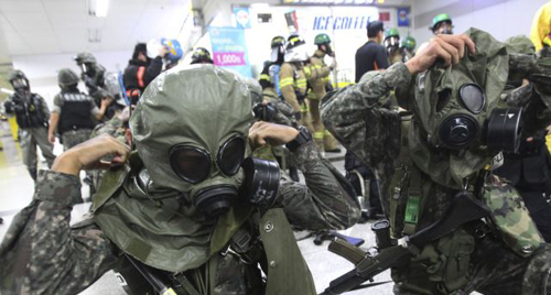 South Korean army soldiers put on gas masks during South Korea-U.S. joint military exercise,