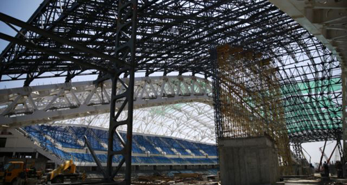 The Fisht Olympic Stadium is pictured under construction for the 2014 Winter Olympic Games in Sochi on Aug. 20, 2013. /Reuters