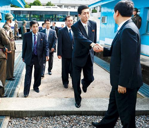 North Korean delegates arrive at the border truce village of Panmunjom for talks about cross-border family reunions on Friday. /Courtesy of the Unification Ministry