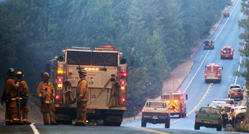 Fire crews line up along Highway 120 at the Rim Fire in this undated United States Forest Service handout photo near Yosemite National Park, California. /Reuters