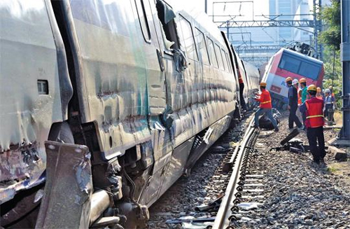 A slow train is left wrecked after colliding with a KTX at Daegu Station on Saturday.