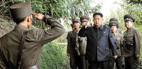 North Korean leader Kim Jong-un inspects a military unit on Wolnae Island near the western sea border with South Korea, in this photo released on Wednesday by the [North] Korean Central News Agency.