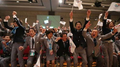 Tokyo 2020 delegation celebrates as city is awarded Summer Games during 125th IOC session in Buenos Aires on Sept. 7, 2013. /AP