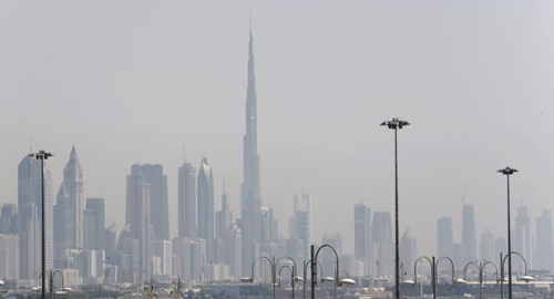 The skyline is seen with the Burj Khalifa as ships dock at Port Rashid, in Dubai on May 26, 2013. /Reuters