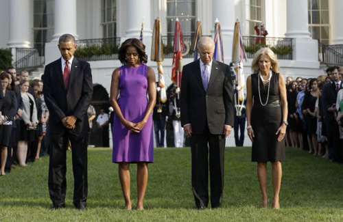 President Barack Obama, first lady Michelle Obama, Vice President Joe Biden, and Jill Biden bow their heads for a moment of silence on the South Lawn of the White House in Washington on Sept. 11, 2013. /AP