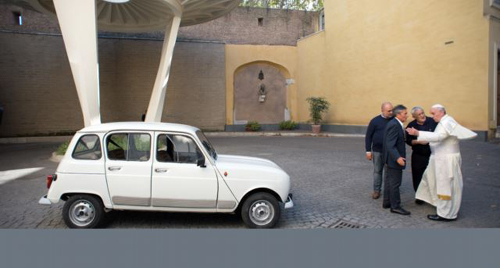 This handout picture released by the Vatican Press Office shows Father Don Renzo Zocca offering his white Renault 4L to Pope Francis during a meeting at the Vatican on Sept. 7, 2013. /AFP