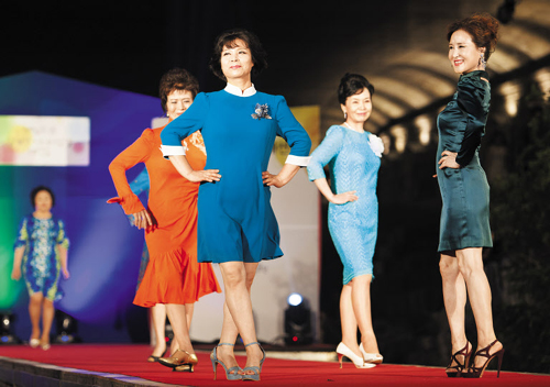 Models pose during a senior fashion show in Seoul on July 6.