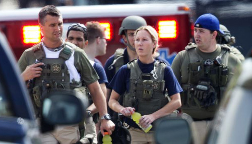 Police who responded to shooting at the Washington Navy Yard on Sept. 16, 2013, leave the facility. /AP