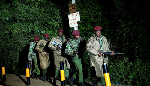 Kenyan Defense Forces leave the near vicinity of the Westgate Mall in Nairobi Kenya on Sept. 23, 2013. /AP